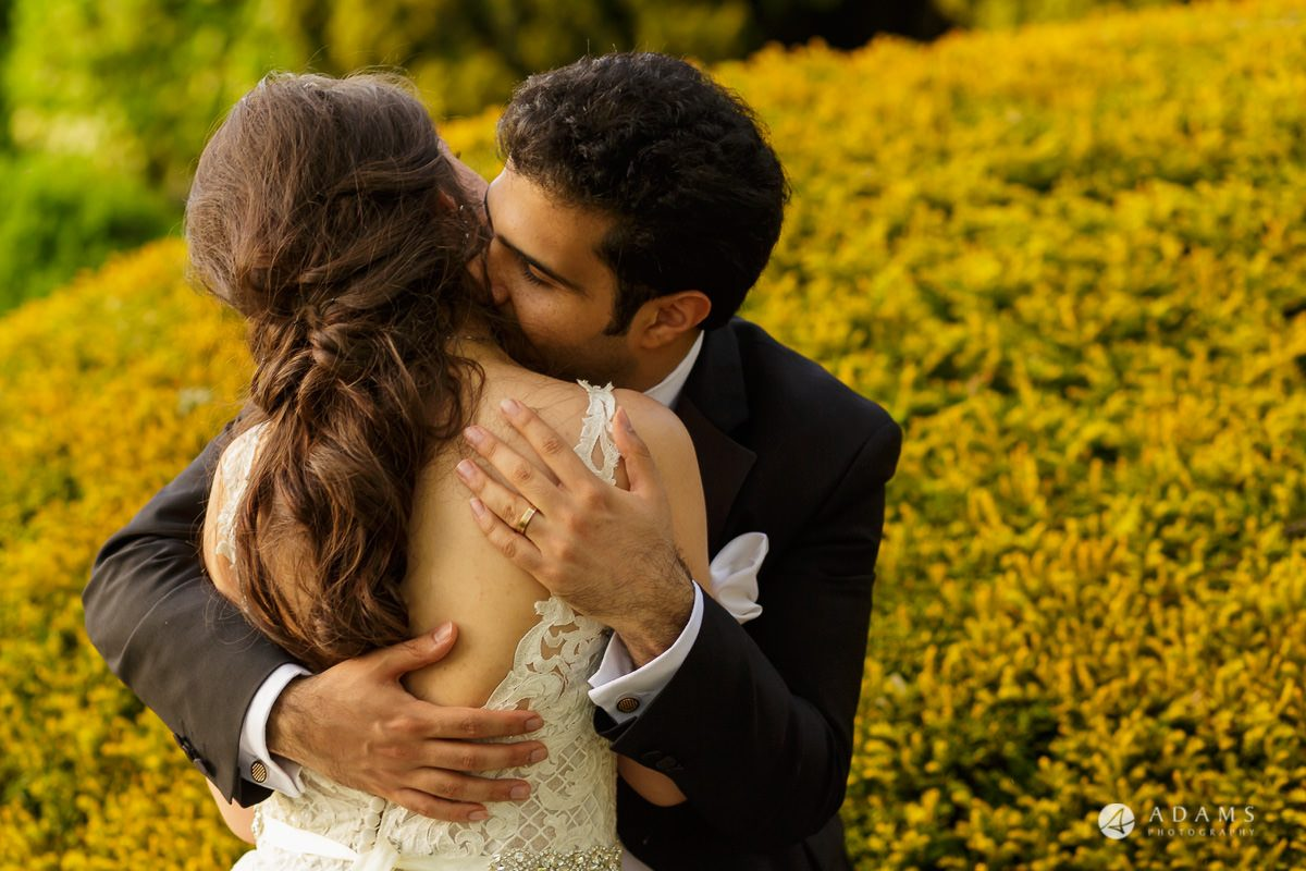 pinewood studios wedding photography the couple hugs each other during the golden hour