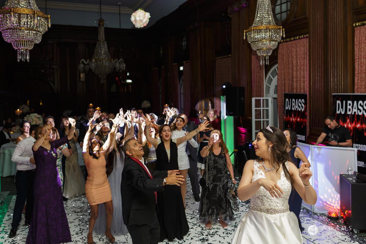 pinewood studios wedding bride throwing her bouquet