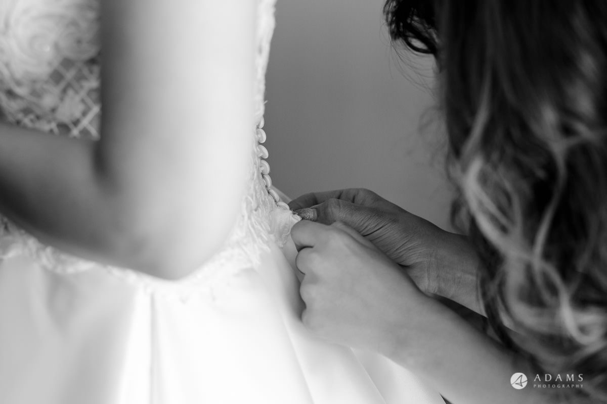 pinewood studios wedding bride putting her dress on