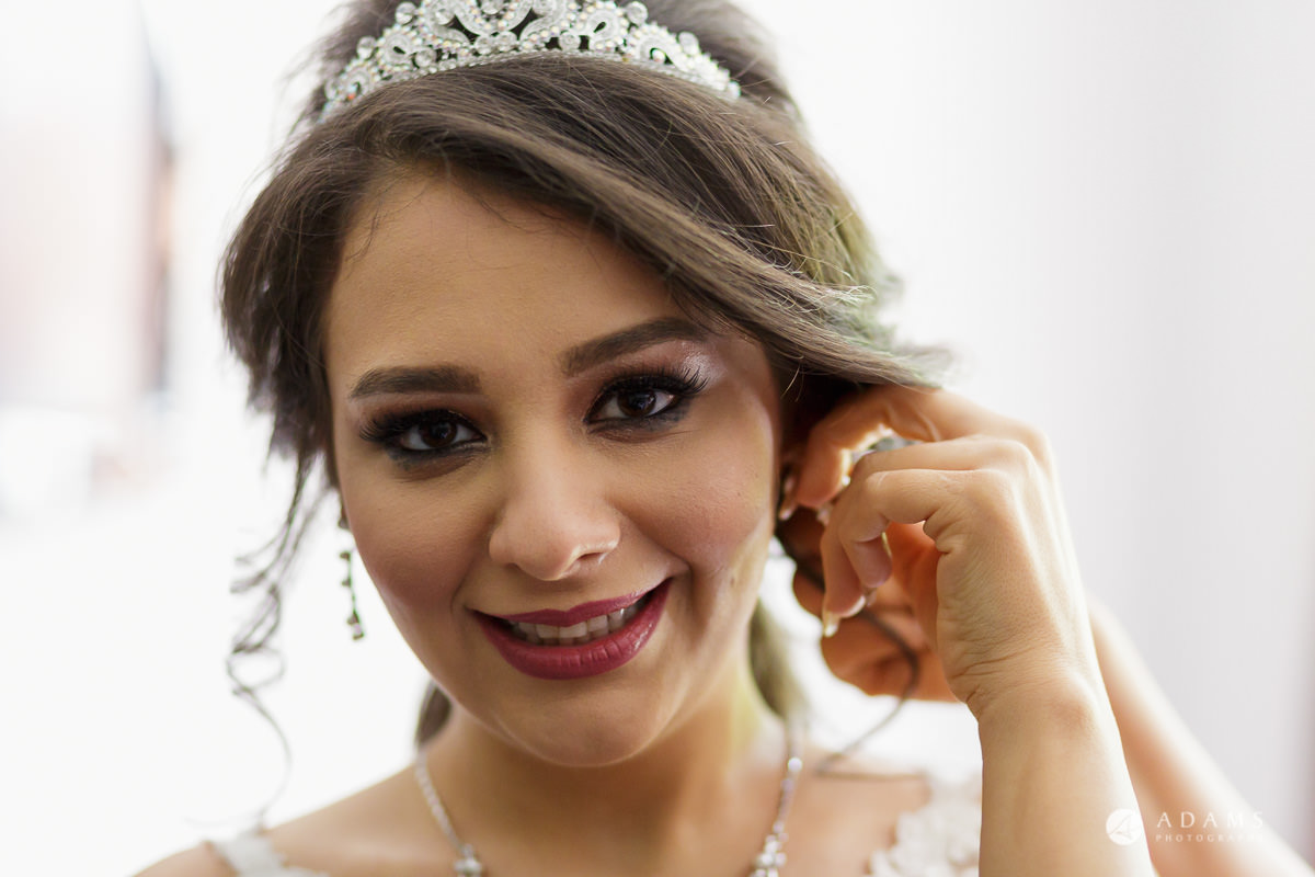 pinewood studios wedding bride putting on the earrings