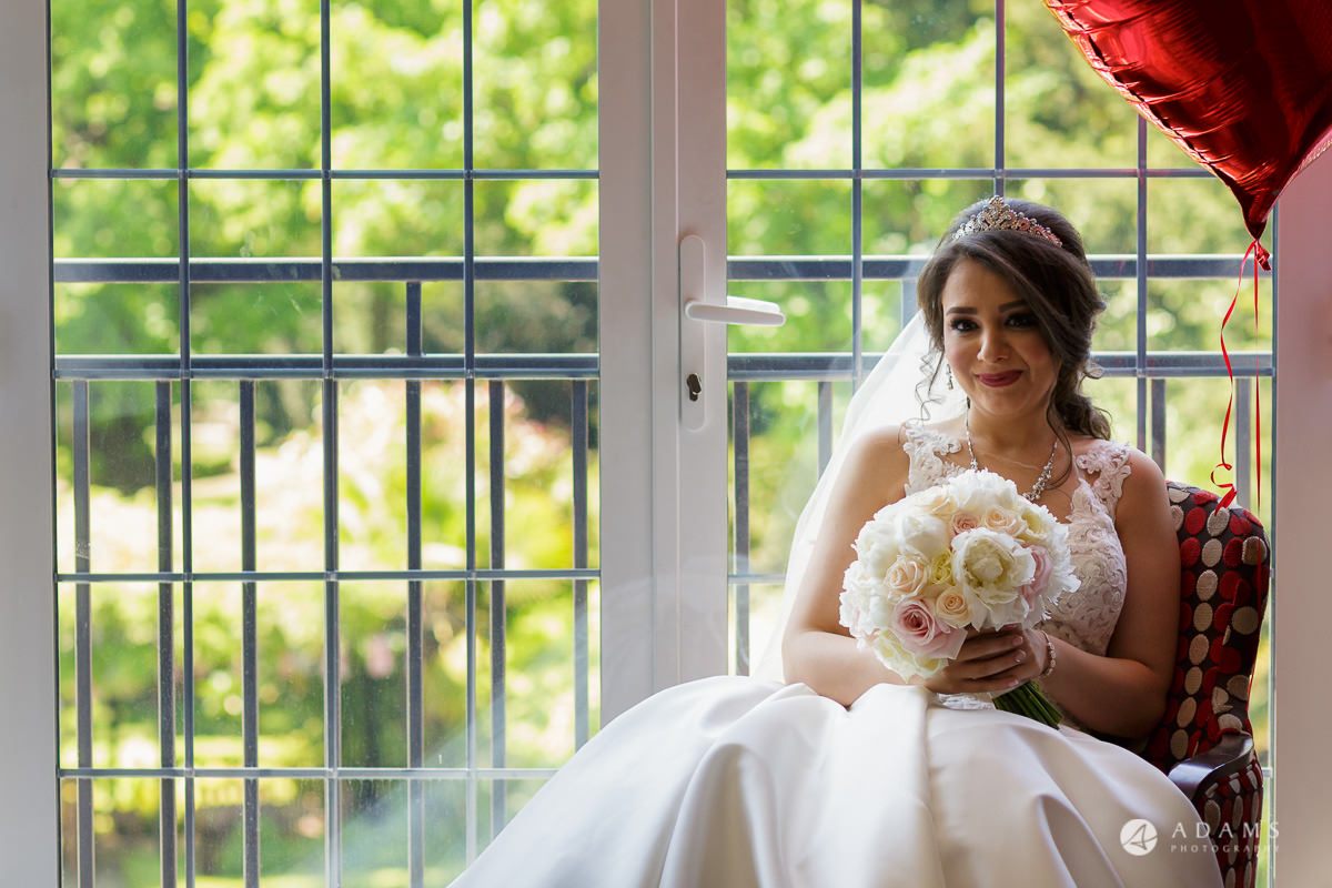 pinewood studios wedding bride sitting on the sofa and posing