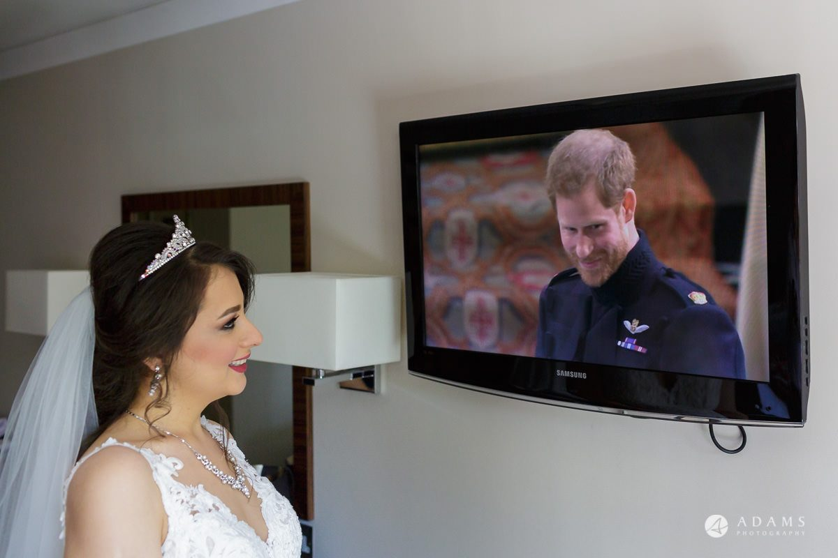 pinewood studios wedding bride looking at the tv while the royal wedding is transmitted