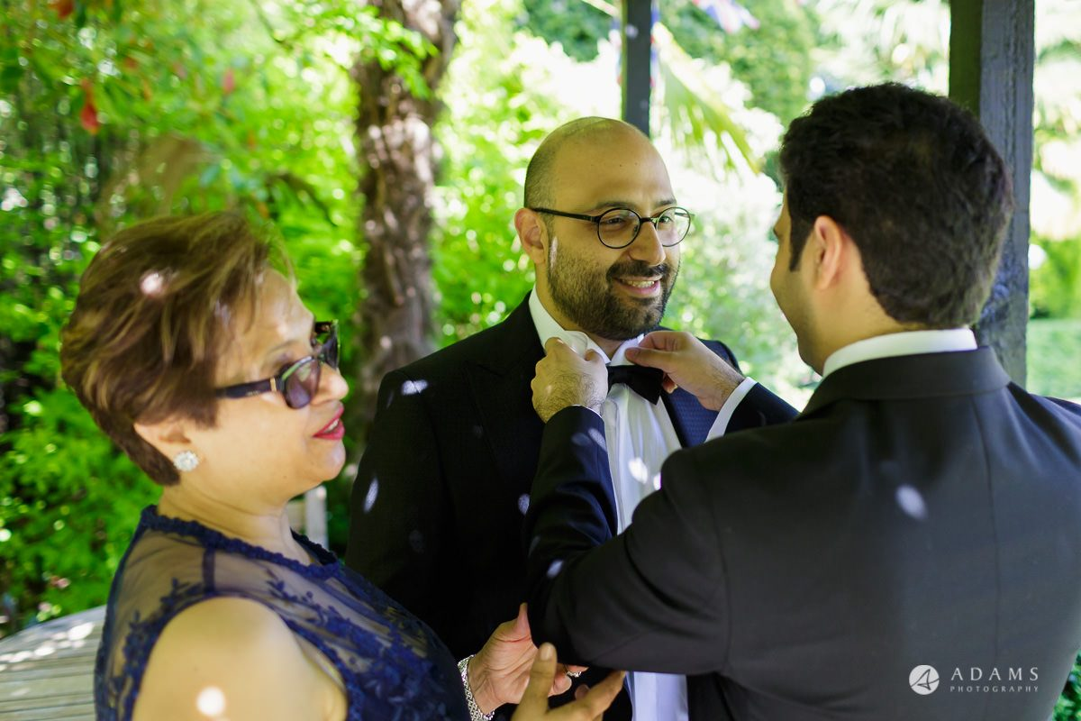 pinewood studios wedding groom fixes his brother tie