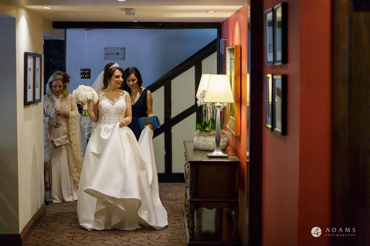 pinewood studios wedding bride walks in the corridor to see the groom