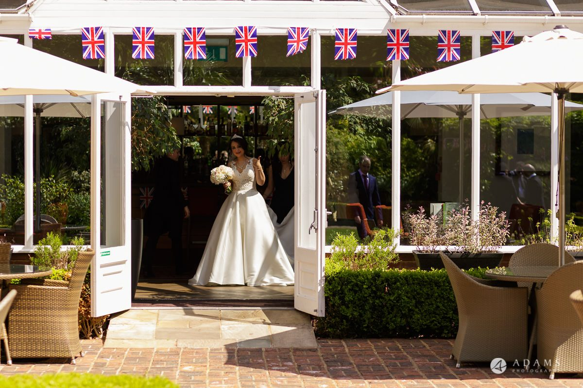 pinewood studios wedding bride stand by the entrance
