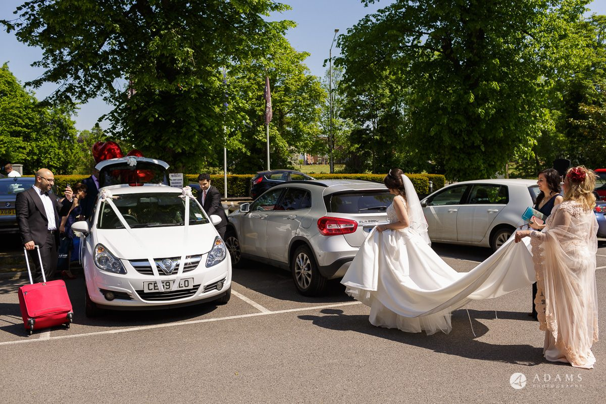 pinewood studios wedding bride and groom walk to the car