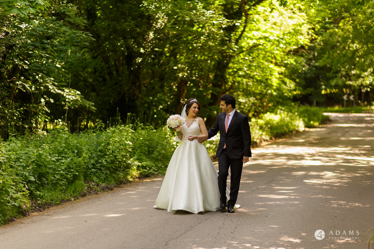 pinewood studios wedding bride and groom walk together in the woods