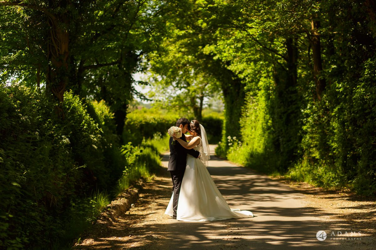 pinewood studios wedding bride and groom hugs each other