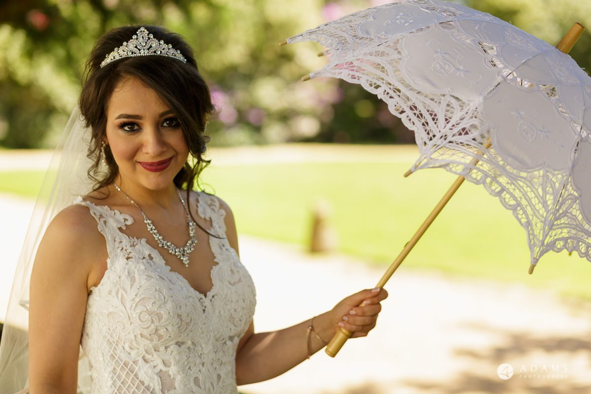 pinewood studios wedding bride posing with umbrella in her hand