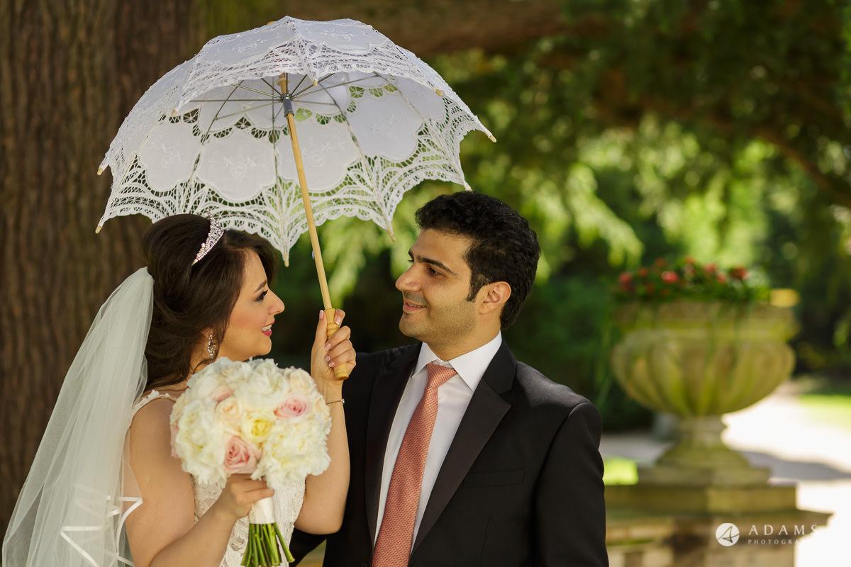 pinewood studios wedding bride and groom under the umbrella