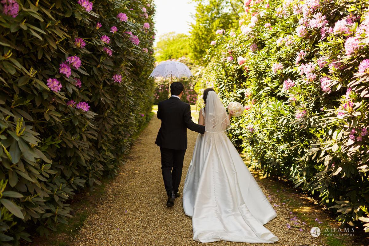 pinewood studios wedding bride and groom walk together
