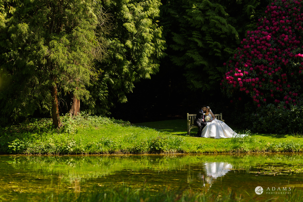 pinewood studios wedding bride and groom by the pond