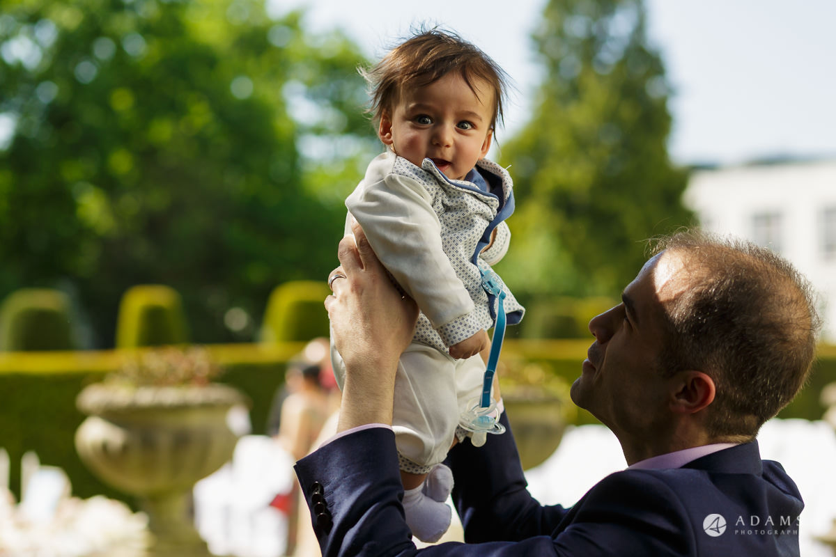 pinewood studios wedding guest holds a baby in his hands