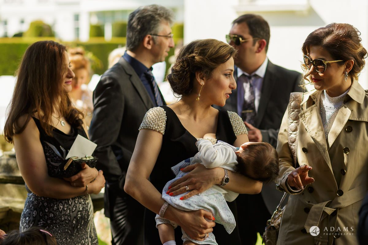 pinewood studios wedding female guest holds her baby