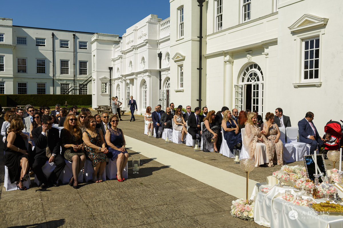 pinewood studios wedding guests sit on the chairs
