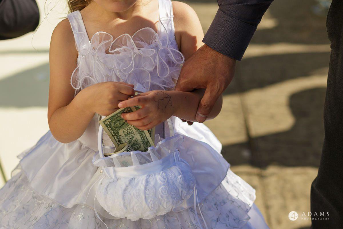 pinewood studios wedding flower girl holds the bucket