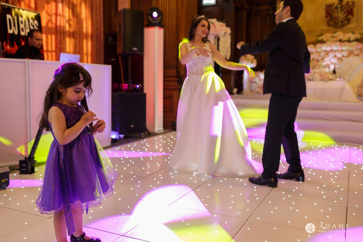 pinewood studios wedding photography kids dancing with the married couple