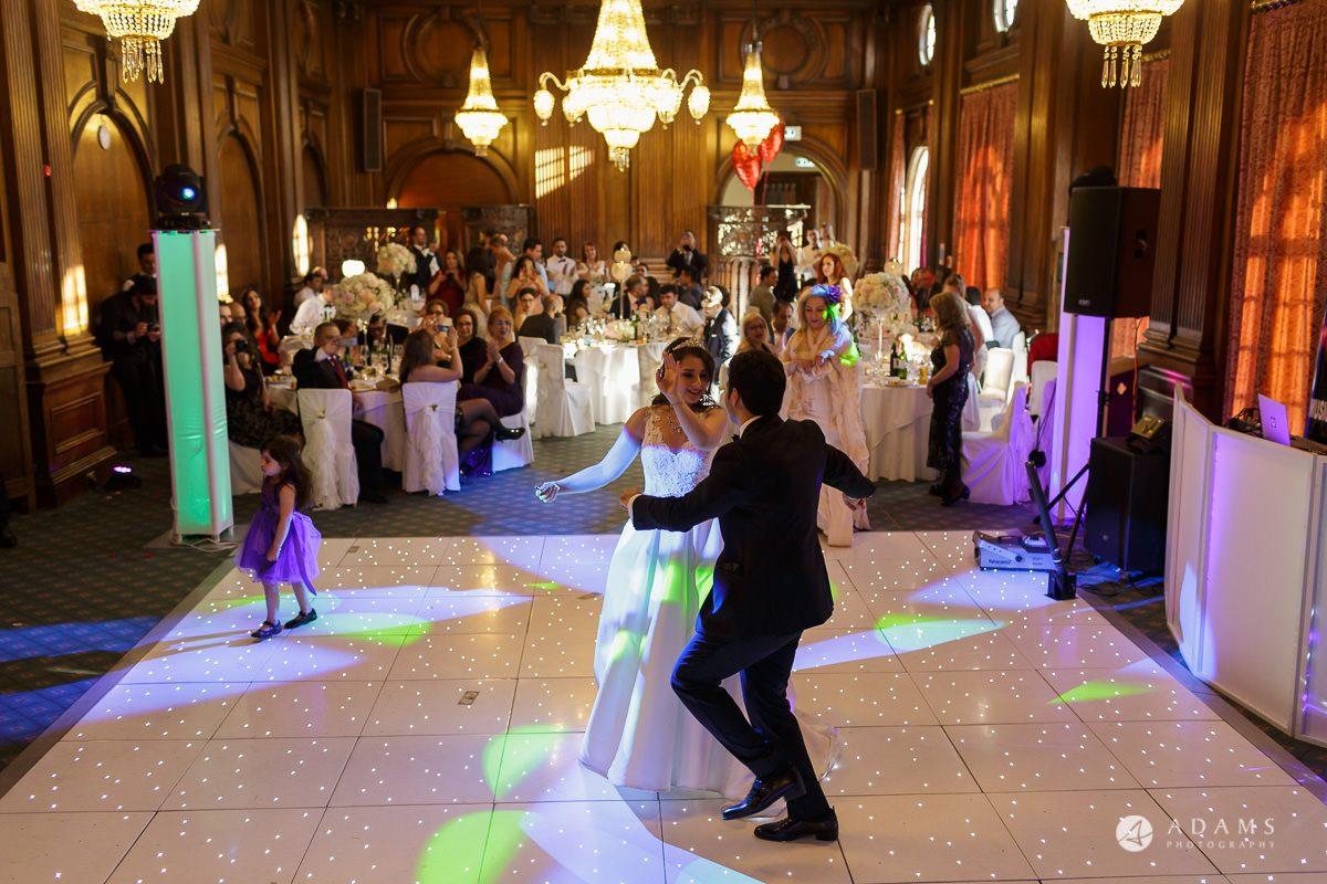 pinewood studios wedding photography marreid coupel dance in front of their guests