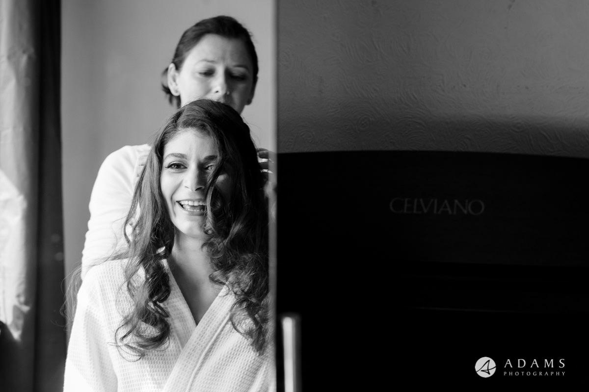 Royal Holloway Wedding bride looking in the mirror