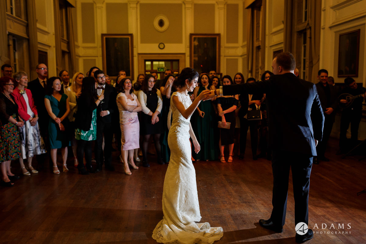 Royal Holloway wedding photography of first dance wide view with guests