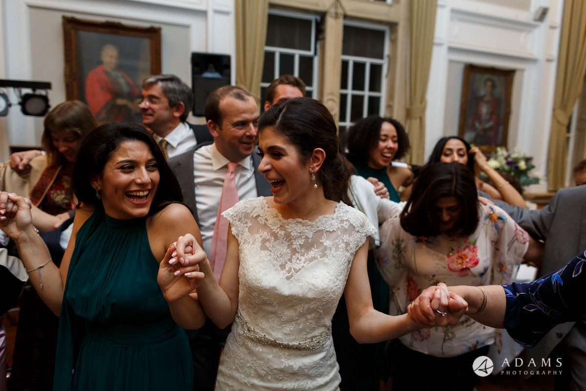 Royal Holloway wedding photography bride and bridesmaid dancing