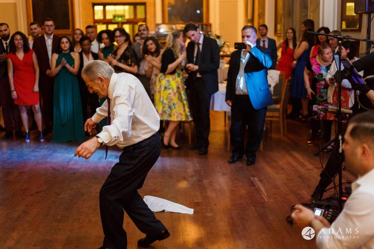 Royal Holloway wedding photographer brother of the bride and father greek dance