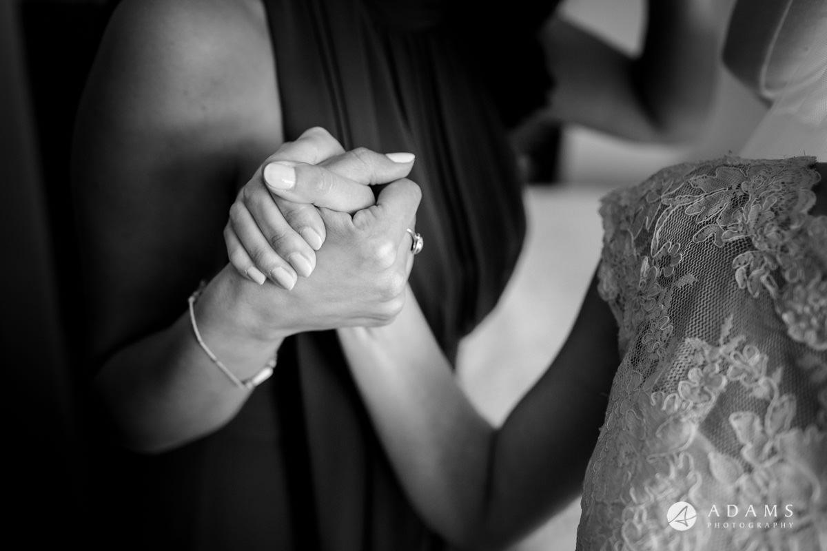 Royal Holloway Wedding bride and her bridesmaid shake hands