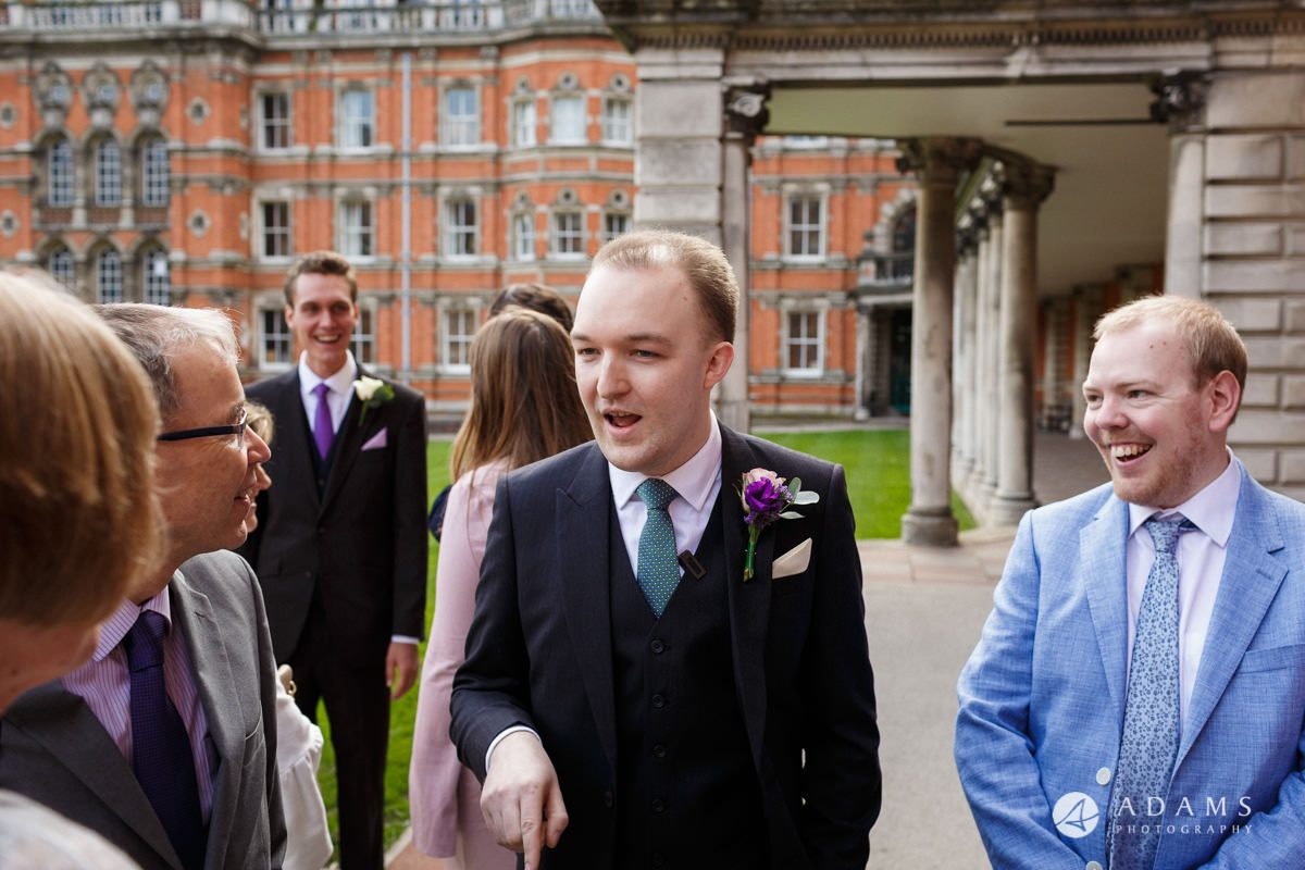 Royal Holloway Wedding groom talks to his guests