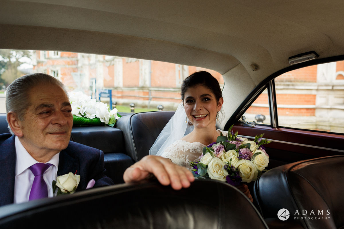 Royal Holloway Wedding bride in the wedding car with her father
