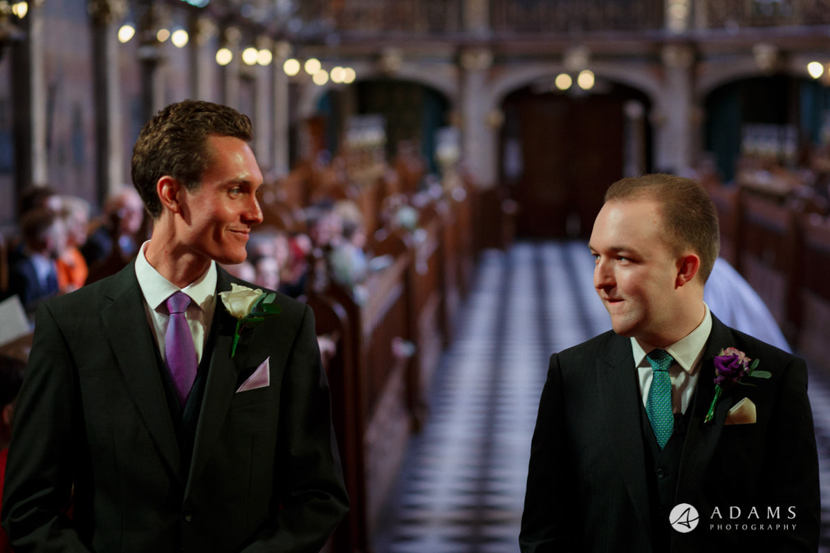 Royal Holloway Wedding groom talks to his best man in the chapel