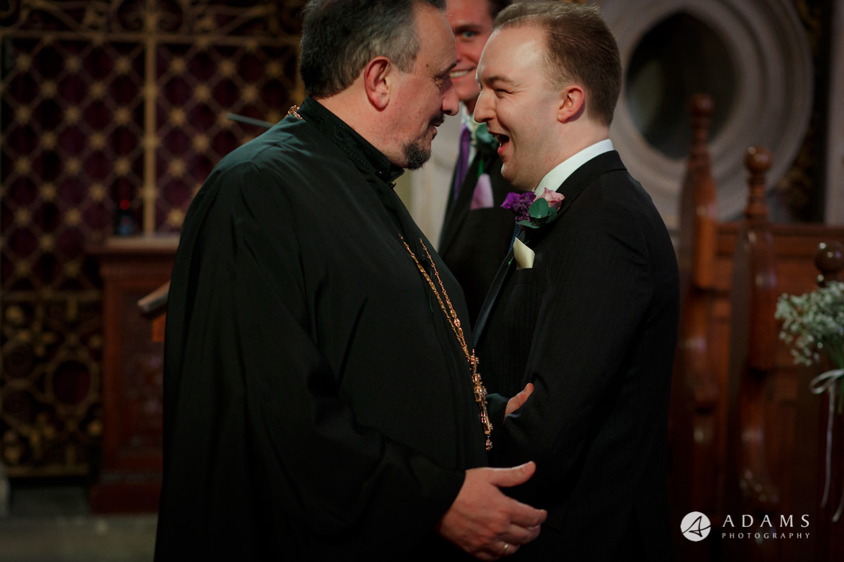Royal Holloway Wedding groom welcomes the priest