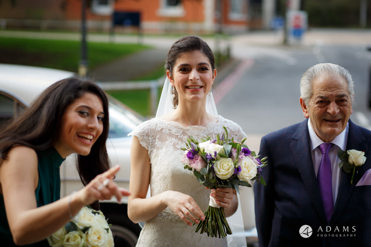 Royal Holloway Wedding bride and her bridesmaid chat just before entering the chapel