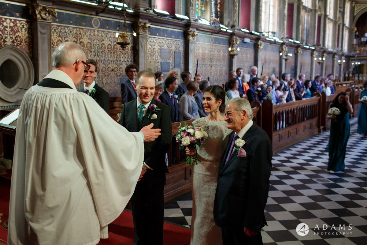 Royal Holloway wedding groom welcomes the bride and her father