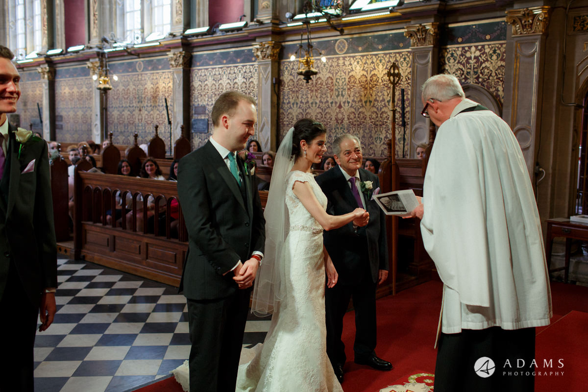 Royal Holloway wedding priest gives the rings