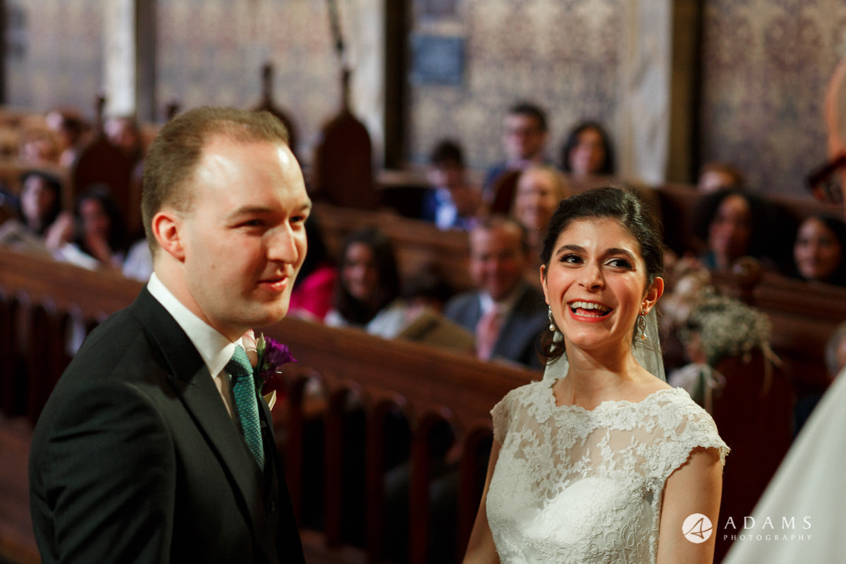 royal holloway wedding married couple looks at the priest