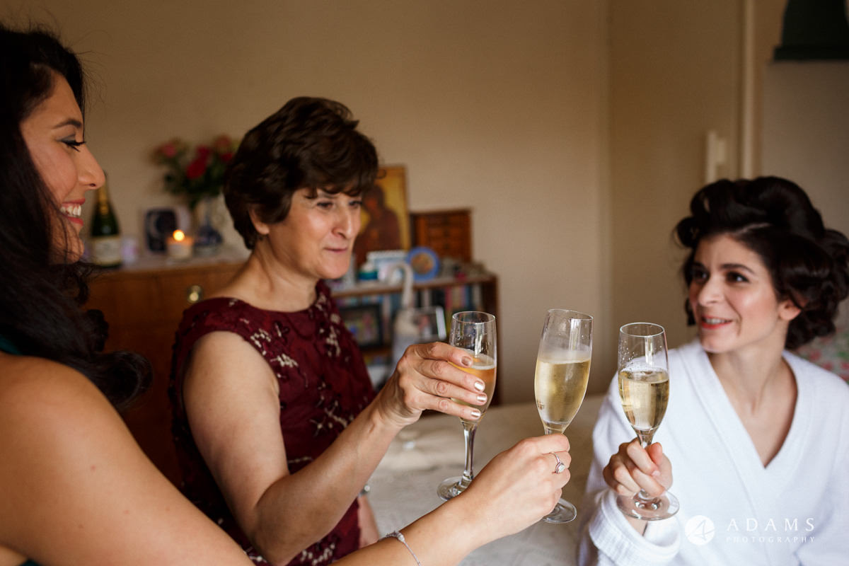 Royal Holloway Wedding bridal party drinking champagne during the getting ready