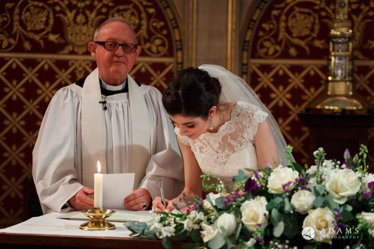 royal holloway wedding bride signing the registrar