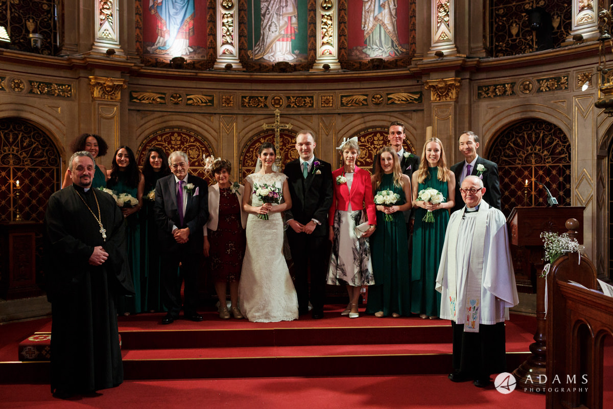 royal holloway wedding group photo in the chapel