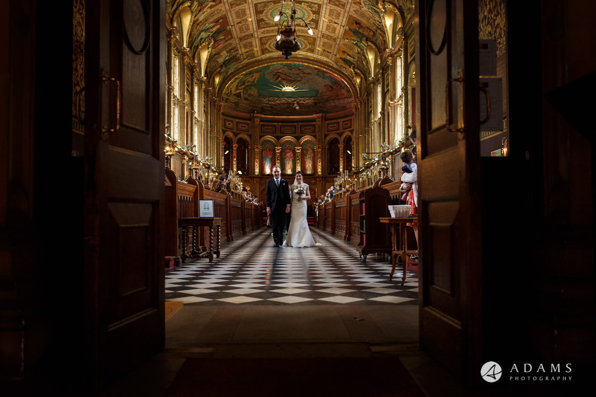 royal holloway wedding bride and groom walk out of the chapel