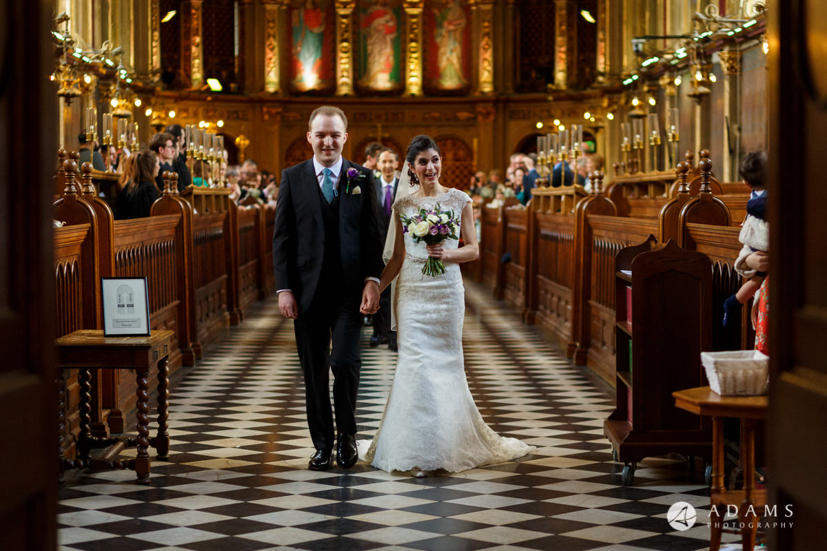 royal holloway wedding bride and groom walking out