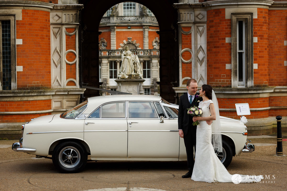 royal holloway wedding photographer bride and groom by the car