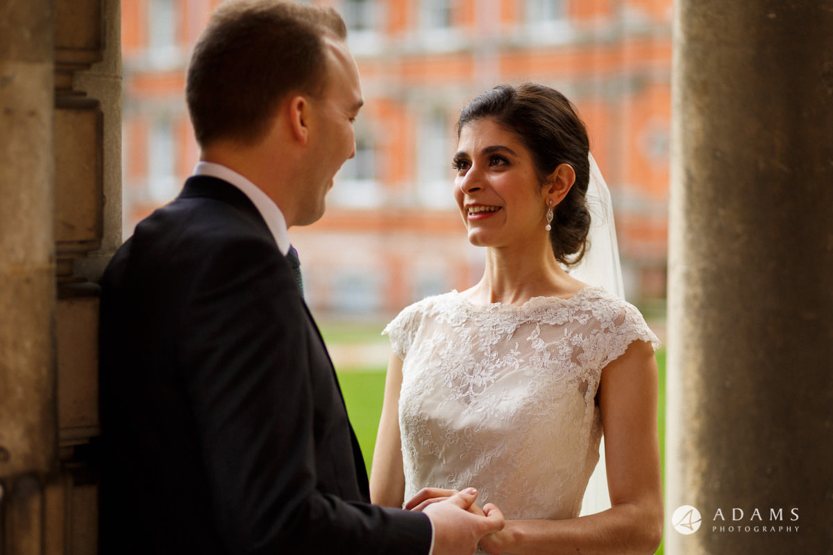 royal holloway wedding bride looking at the groom during photo session