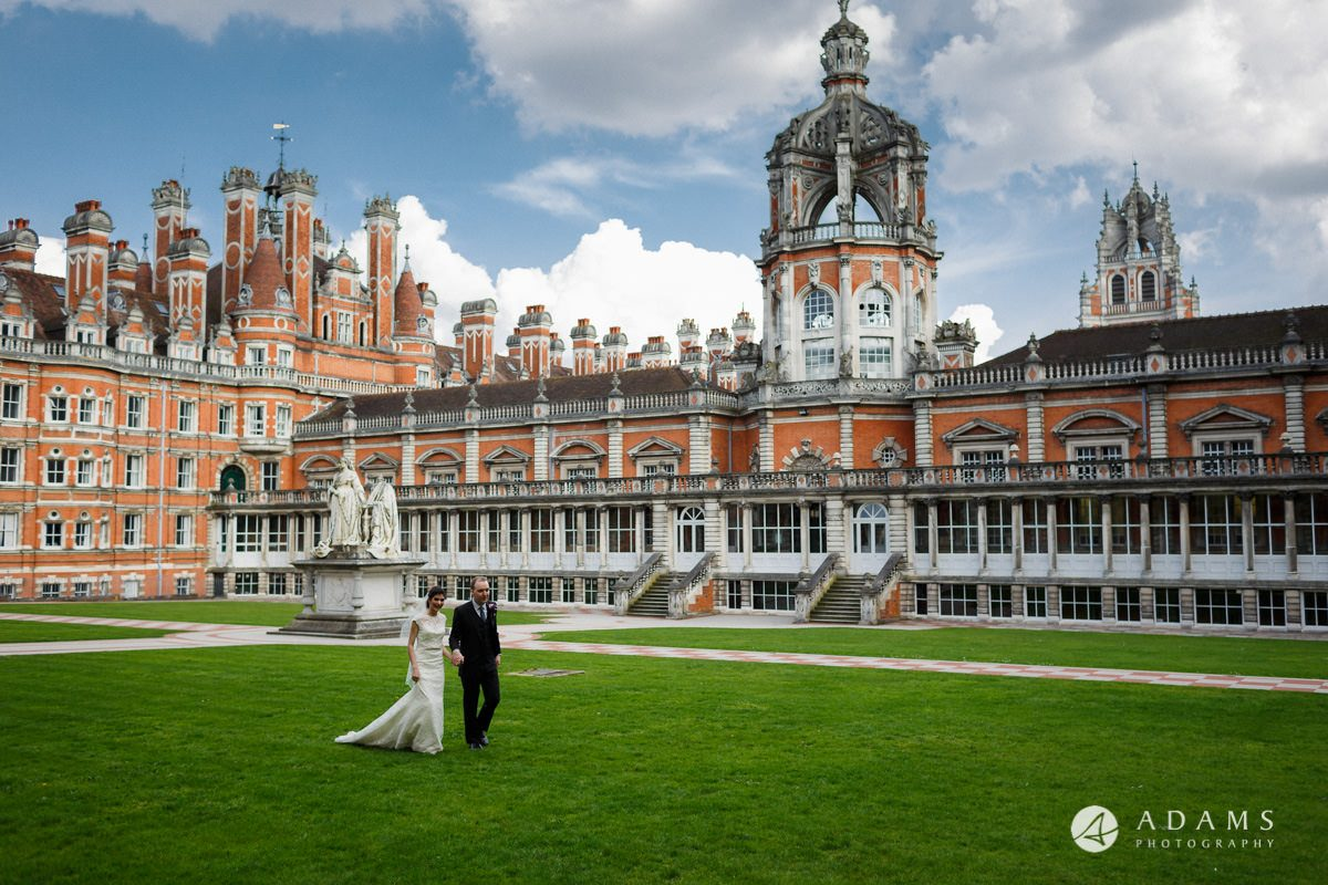 royal holloway wedding married couple walking across the courtyard