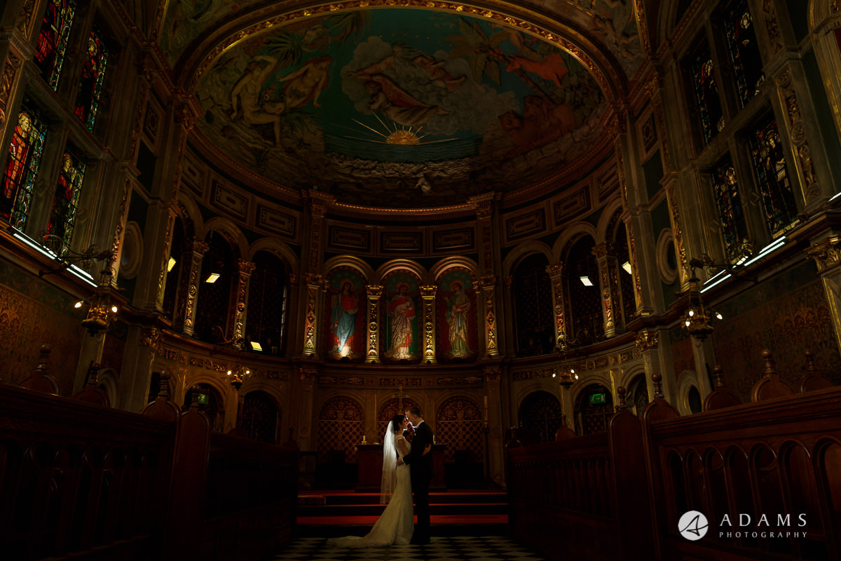 Royal Holloway wedding bride and groom in the chapel photo shoot