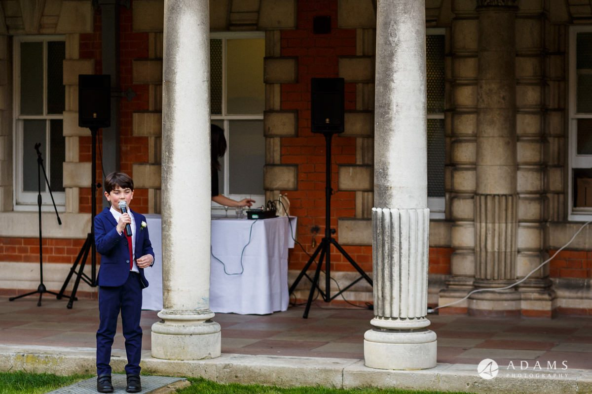 royal holloway wedding young boy sining