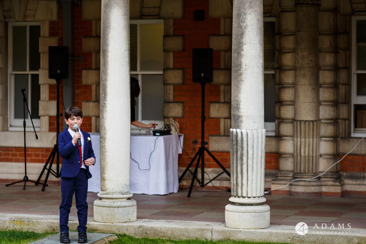 royal holloway wedding young boy sining