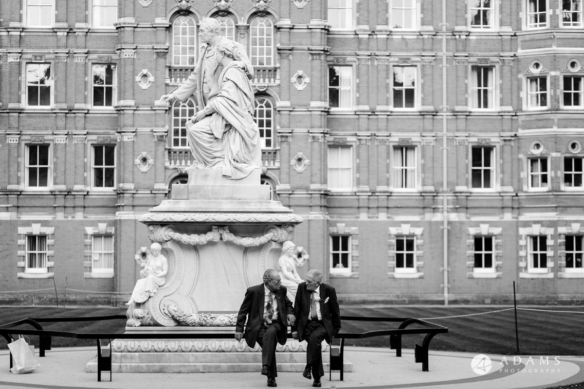 royal holloway wedding parents siting by the monument