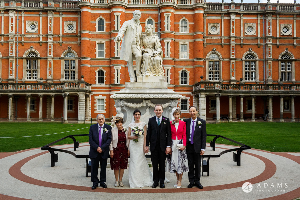 royal holloway wedding couple with the parents