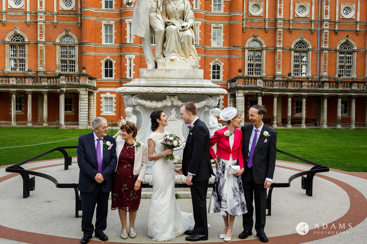 royal holloway wedding couple looking at each other group photo