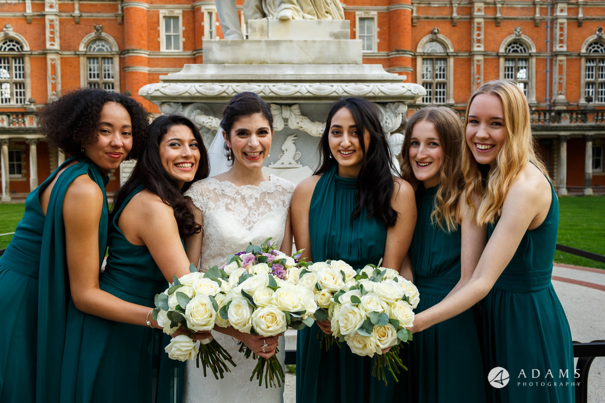 royal holloway wedding bridesmaids holding flowers